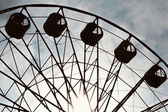 Aged and worn vintage photo of ferris wheel — Stock Photo