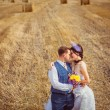 Bride and groom with veil near hay — Stock Photo #56726651