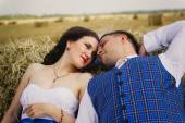Bride and groom with veil near hay — Stock Photo