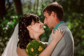 Married Couple in forest embracing — Stock Photo