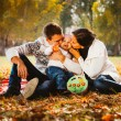 Picture of lovely family in autumn park, young parents with nice adorable kids playing outdoors, five cheerful person have fun on backyard in fall, happy family enjoy autumnal nature — Stock Photo #57516949