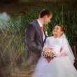 Beautiful lovely bridal couple standing near lake — Stock Photo #59535641