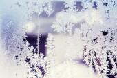 Ice patterns on winter glass — Stock Photo