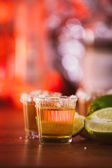 Tequila , lime and salt on wooden table — Stock Photo