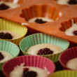 Rows of colorful cups. Muffins preparation at home. — Stock Photo #68354795