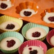 Rows of colorful cups. Muffins preparation at home. — Stock Photo #68354847