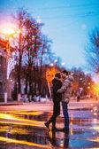 Snow lovers kiss city — Stock Photo