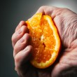 Man dramatic squeezes orange. Conceptis tired from work. — Stock Photo #70270875