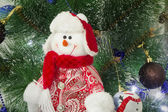 Amusing figure of a snowman on a Christmas fir-tree. — Stock Photo