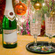 Christmas holiday, wine and glasses near a Christmas fir-tree. — Stock Photo #58127931