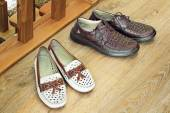 Two pairs of comfortable shoes : for men and for women. — Stock Photo