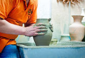 People at work: the production of ceramic vases on a Potter's wh — Stock Photo