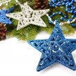 Blue glitter Christmas star decoration and Christmas tree branch on white — Stock Photo #56829985
