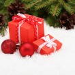 Christmas gift boxes and Christmas tree branch — Stock Photo #57764641