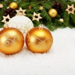 Three balls and Christmas tree branch — Stock Photo #57764649