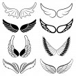 Set of eight black and white silhouettes of wings — Stock Vector #54190357