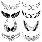 Set of eight black and white silhouettes of wings — Vector de stock