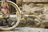 Bicycle wheel on a cobblestone street — Stock Photo