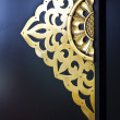 Golden asian decoration on a black door — Stock Photo #58819149
