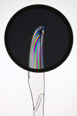 Knife on a circular polarized filter — Stock Photo