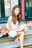 Beautiful girl working outdoors — Stock Photo