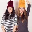 Funny girl friends with wool caps — Stock Photo #53656859