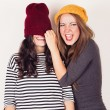 Funny girl friends with wool caps — Stock Photo #53657429