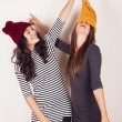 Funny girl friends with wool caps — Stock Photo #53657473