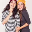 Funny girl friends with wool caps — Stock Photo #53658107