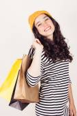 Happy autumn or winter girl with wool cap shopping — Stock Photo