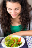 Healthy and happy young woman eating salad — Stock Photo