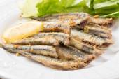 Fried anchovies with salad — Stock Photo