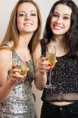 Party girls with champagne — Stock Photo