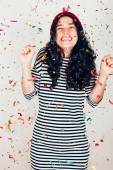 Happy party girl with confetti — Stock Photo