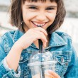 Little girl drinking a smoothie — Stock Photo #62144979