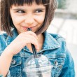 Little girl drinking a smoothie — Stock Photo #62145665