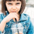 Little girl drinking a smoothie — Stock Photo #62145669