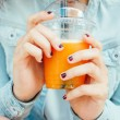 Teen girl hands with a fruit smoothie — Stock Photo #62146043
