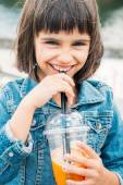 Little girl drinking a smoothie — Stock Photo