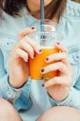 Teen girl hands with a fruit smoothie — ストック写真