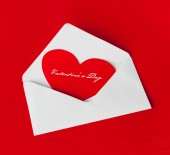 Scarlet heart in a white envelope — Stock Photo