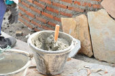 Bucket of mortar with trowel — Stockfoto
