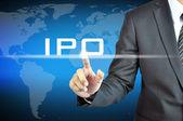 Podnikatel je ruka se dotýká Ipo znamení — Stock fotografie
