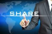 Businessman's hand touching SHARE word — Stock Photo