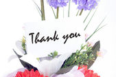 """Flower bouquet with """" Thank you """" on  tag card — Stock Photo"""