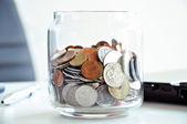 Coins in the glass jar - multi Asian currencies — Stock Photo