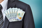 Dollar banknotes in pocket of businessman's suit — Stock Photo