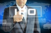 Businessman's hand touching IPO sign — Stock Photo