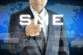 Hand pointing to SME — Stock Photo