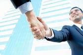 Handshake of businessmen — Stock Photo